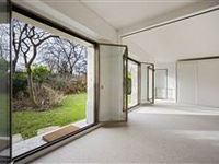 LOVELY APARTMENT WITH A GARDEN BATHED IN SUNSHINE AND ENJOYING A VIEW OF THE EIFFEL TOWER.