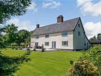 BEAUTIFUL AND SPACIOUS FARMHOUSE WITH BARNS SET ON PICTURESQUE 15 ACRES
