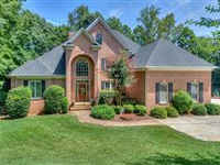 IMPRESSIVE LAKE NORMAN WATERFRONT HOME INCLUDES A BEAUTIFULLY LANDSCAPED YARD