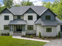 JUST COMPLETED NEW CONSTRUCTION IN COVETED LOCATION