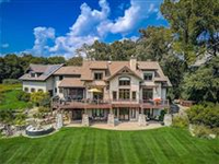 EXECUTIVE CUSTOM-BUILT EUROPEAN STYLE ESTATE WITH AMAZING COUNTRY SIDE VIEWS