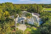 WELL-MAINTAINED POOL HOME WITH GOLF AND LAKE VIEWS