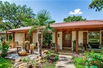 BEAUTIFULLY UPDATED HOME WITH STUNNING GARDENS AND KOI POND