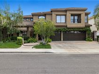 ELEGANT AND LUXURIOUS EXECUTIVE HOME IN GATED OCEAN RANCH COMMUNITY