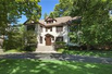 LOVELY STUCCO HOME WITH CLASSIC ARCHITECTURAL DETAILS