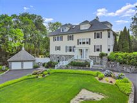 BEAUTIFULLY RENOVATED AND EXPANDED SIX BEDROOM HOME