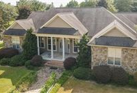 CUSTOM BUILT HOME OFFERING PANORAMIC VIEWS AND AN EQUESTRIAN FACILITY