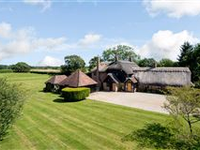 A STRIKING HOME WITH WONDERFUL FAR REACHING VIEWS IN GARDENS AND GROUNDS