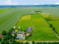 SPACIOUS FARMHOUSE ON EIGHTEEN EXCEPTIONAL EQUESTRIAN ACRES
