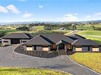 PICTURESQUE BRICK AND REDWOOD RESIDENCE IN PUKEKOHE