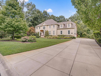 STUNNING TWO-STORY ON A PRIVATE WOODED LOT