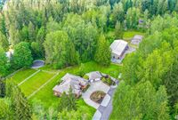 QUALITY CUSTOM HOME AND STATE-OF-THE-ART EQUESTRIAN FACILITY