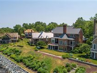 SHOW STOPPING UNOBSTRUCTED SOUTH RIVER VIEWS IN THIS IMMACULATE HOME
