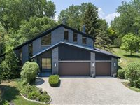 A TIMELESS MODERN HOME NESTLED ON AN ACRE OF PRIVACY