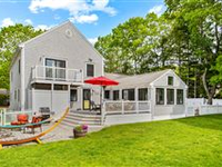 A STUNNING CUSTOM COLONIAL LOCATED STEPS FROM A PRIVATE BEACH