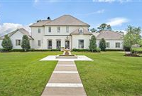 REMARKABLE HOME SITUATED ON AN EXPANSIVE GOLF COURSE LOT