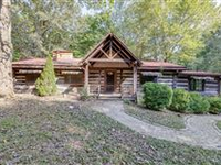 UNIQUE LOG HOUSE ON THIRTY-FIVE ACRES OF WOODED LAND