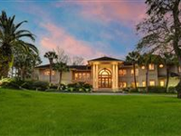 CONTEMPORARY ELEGANCE WITH NEARLY FIVE ACRES ON THE VERMILION RIVER