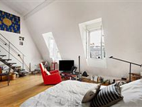 THIS BRIGHT SPLIT-LEVEL APARTMENT ENJOYS A LOVELY OPEN VIEW