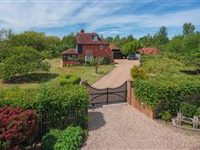 A RURAL RETREAT BEAUTIFULLY SITED IN AN OASIS OF WILDERNESS IN THE HAM FEN NATURE RESERVE