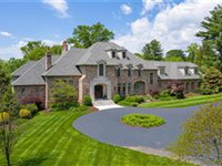 EXQUISITE HOME ON THREE ACRES IN THE HEART OF LADUE