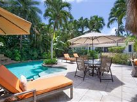 CHIC AND CHARMING HOME ON A PRIVATE AND TROPICALLY LANDSCAPED CORNER LOT