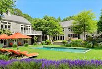 A BEAUTIFULLY LANDSCAPED FOUR-ACRE PROPERTY