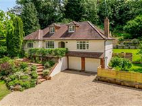 UNIQUE AND VERSATILE HOME IN A TUCKED AWAY BUT CONVENIENT LOCATION