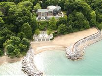 SPECTACULAR ESTATE WITH MESMERIZING LAKE VIEWS ANDBEACH LIKE NO OTHER!