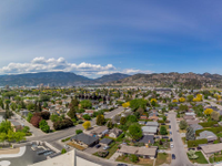 PENTHOUSE WITH SERENE MOUNTAIN VIEWS IN THE HEART OF KELOWNA