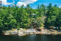 AN OASIS OF PRIVACY AND QUIETUDE ON A PRISTINE SMALL LAKE