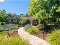 THIS IMPECCABLY LANDSCAPED RANCH HAS BEEN TASTEFULLY REMODELED THROUGHOUT