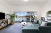 EXCLUSIVE WATERFRONT TOWNHOME