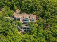 SPECTACULAR LAKE DREAM HOME WITH MULTI-MILLION DOLLAR VIEWS