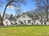 THIS TASTEFULLY UPDATED HOME OFFERS CHARMING CURB APPEAL