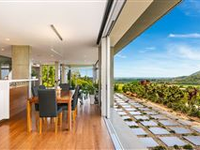 EXCEPTIONAL HIGH QUALITY HOME ELEVATED ABOVE THE SURROUNDING LANDSCAPE