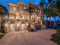 PRIVATELY SITUATED CUSTOM GULF-ACCESS HOME