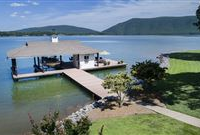 STUNNING LAKEFRONT HOME ON A POINT LOT