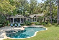 TIMELESS ELEGANCE ATOP A PREMIER WATERFRONT LOT